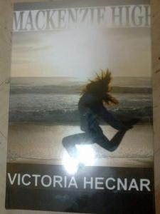 A self-published hard cover copy of Mackenzie High. Copyright © 2012-2014 by Victoria Hecnar