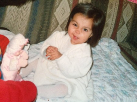Fancy baby Victoria Hecnar. Look at me making faces and wearing red nail polish and stuff.